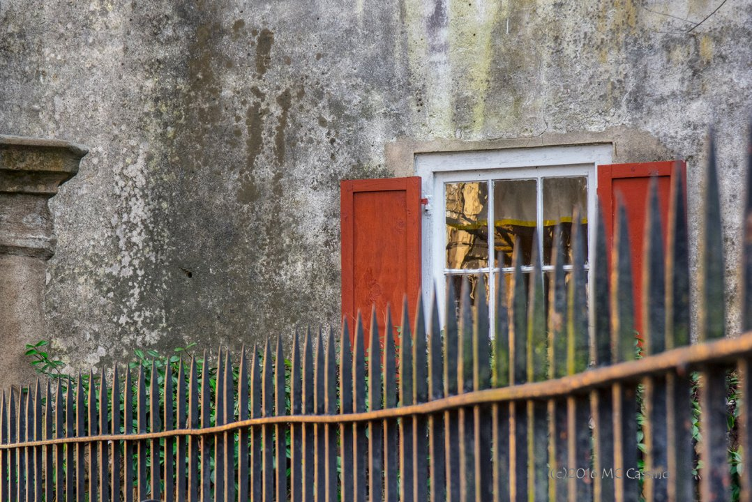 Red Shutters and Wrought Iron