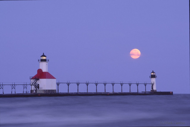 Lighthouse at St. Joseph, Michigan with full moon setting behind.