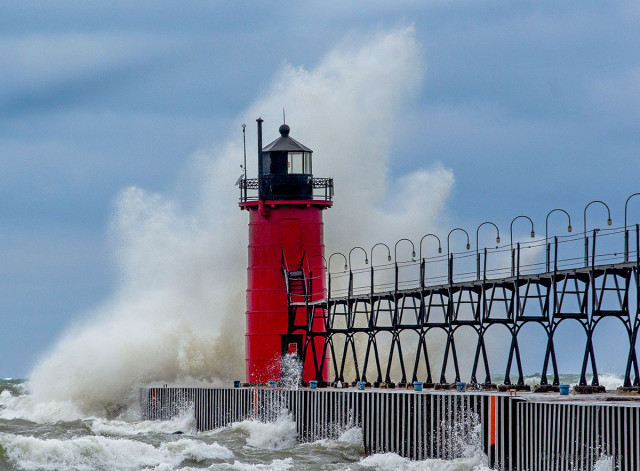Large wave crashing into South Haven, Michigan lighthouse.