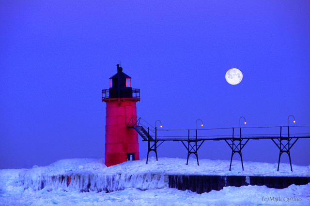 Lighthouse at South Haven Michigan during a winter moonset.